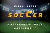 Sports theme Alphabet font set with  numbers on soccer stadium background