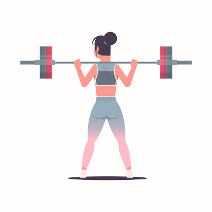 sporty girl lifting weights doing squats with barbell