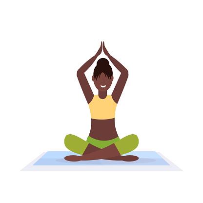 sporty woman sitting lotus pose doing yoga exercises