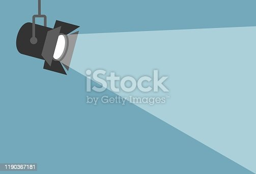 Spotlight shining flat illustration. Movie spotlight on blue background. Vector flat illustration