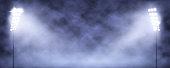Spotlight Towers on Night Stadium in Smoke. Bright Spotlights Flash Flare in Blue Fog Vector Illustration