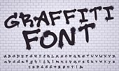 Spray graffiti font. City street art wall tagging lettering, dirty graffiti's numbers and letters. Grunge alphabet, street art graffiti sprayed abc lettering. Isolated vector symbols set
