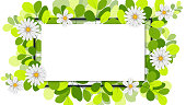 Creative layout made of flowers and leaves with paper card note