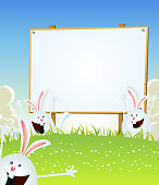Vector illustration of cartoon happy cute easter rabbits jumping in the grass inside spring landscape with wood advertisement sign for march and april holidays celebration. Vector eps and high resolution jpeg included
