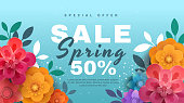 Spring sale banner with paper flowers on a blue background. Banner perfect for promotions, magazines, advertising, web sites. Vector illustration.