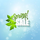 Spring sale sign with leaves and sunshine