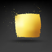 Absolutely unique and realistic gold painted splash. Isolated design element in the middle of black paper background.  Uneven edges of the object and sloppy spots of golden paint around the square give the whole composition an amazing effect! Zoom to see the details. VECTOR FILE.