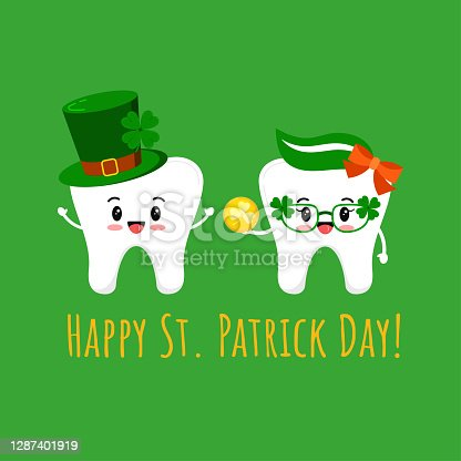 istock St Patrick cute teeth in leprechaun hat and in glasses with gold coin. 1287401919