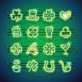 Set of St. Patricks day neon signs makes it quick and easy to customize your holiday projects. Used neon vector brushes included.