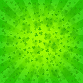 Bright green rays background, lot of clovers. St. Patrick's Day wallpaper. St. Paddy's backdrop template. Comics, pop art style.
