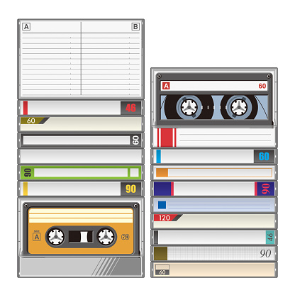Stack of audio cassette tapes in plastic boxes with index cards