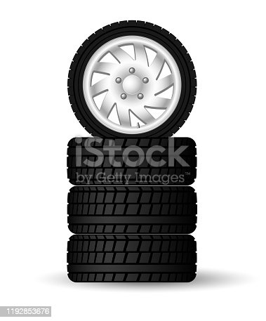 A stack of new four winter tires with rims. For safe and timely seasonal wheel changes