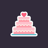 Stacked wedding cake dessert with heart.