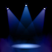 Vector illustration of a fog covered stage, lit up with lights.