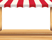 Stall with red awning on white background. Wooden market stall.