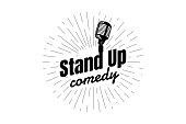 Stand up comedy night live show sign. Retro microphone with inscription and diverging linear rays. Vintage vector illustration EPS