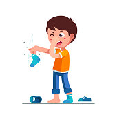 Standing boy kid holding dirty stinky sock in hand closing nose and taking out tongue in disgust face expression. Childhood hygiene flat vector clipart illustration.