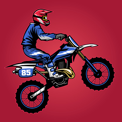 standing motocross rider ride the bike