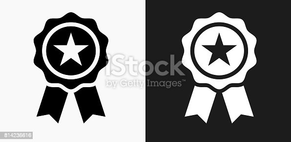 Star Ribbon Icon on Black and White Vector Backgrounds. This vector illustration includes two variations of the icon one in black on a light background on the left and another version in white on a dark background positioned on the right. The vector icon is simple yet elegant and can be used in a variety of ways including website or mobile application icon. This royalty free image is 100% vector based and all design elements can be scaled to any size.