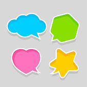 star shaped speech bubble yellow, heart shaped speech bubble pink, hexagon speech bubble green, cloud speech bubble blue, geometry balloon colorful and isolated on grey for copy space