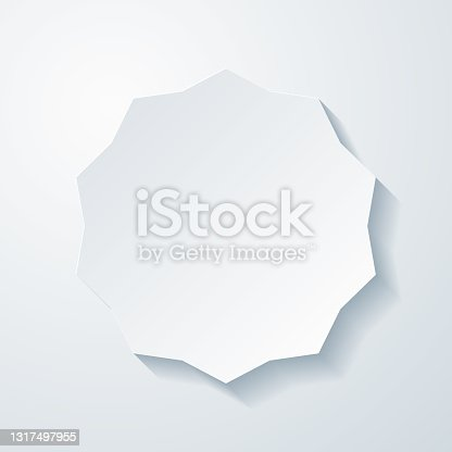istock Starburst sunburst badge. Icon with paper cut effect on blank background 1317497955