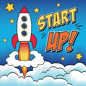 Vector illustration of start up concept with a rocket, clouds and stars. Comic background in pop art style