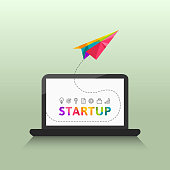 Startup concept with colorful paper plane, laptop and related thin line icons