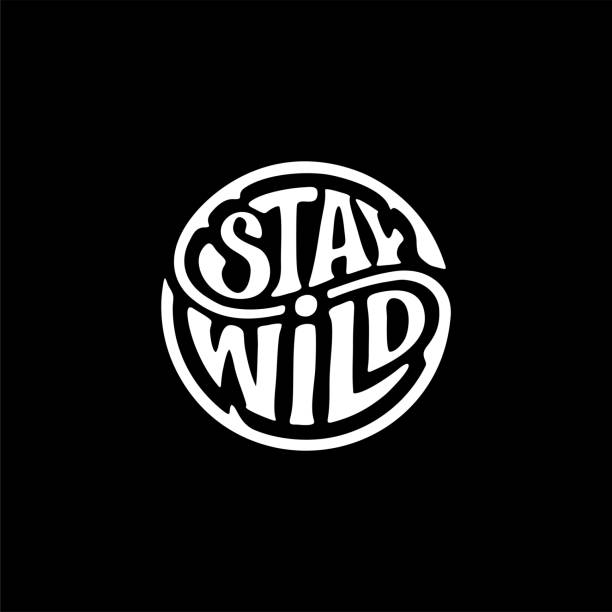 Stay wild circle ink black Vector illustration Stay Wild. Handwritten calligraphic lettering for greeting cards, posters, prints or home decorations. Vector illustration adventure patterns stock illustrations