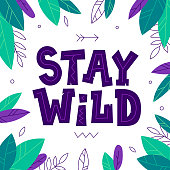 istock Stay Wild quote with leaves frame. Cute vector illustration in tribal style. Inspirational and motivational phrase. 1295929929