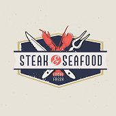 Vector illustration of a set of Steak and Seafood Restaurant Labels with text designs and grill elements. Fully editable EPS 10.