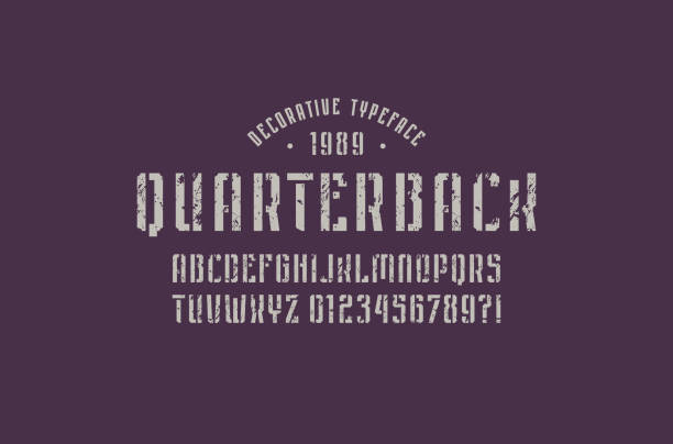 Stencil-plate narrow sans serif font in sport style Stencil-plate narrow sans serif font in sport style. Letters and numbers with rough texture for emblem design. Gray print on dark background quarterback stock illustrations