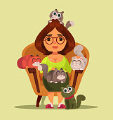 Stereotype independent happy smiling woman sitting on sofa with many cats animals