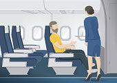 Stewardess brings man the glass of water.  Flight attendant serving passenger.