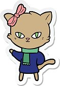 sticker of a cute cartoon cat in winter clothes