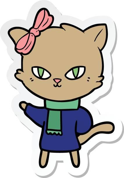 sticker of a cute cartoon cat in winter clothes vector art illustration