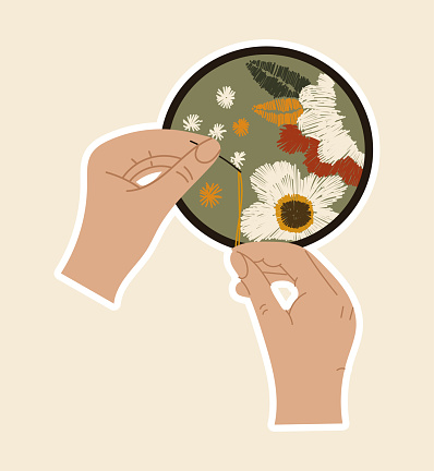 Sticker of hands with needle and thread sewing artwork with flowers