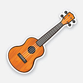 istock Sticker of small classical wooden guitar 922692948
