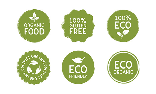 Stickers for Organic and Eco friendly products in minimal vintage design. Vector Eco badges in circle shape with leaves icons isolated on white background.