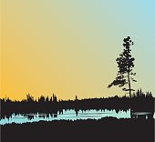 A vector silhouette illustration of a lonely tree standing above a pond in a field reflecting the grass and an evening sky.