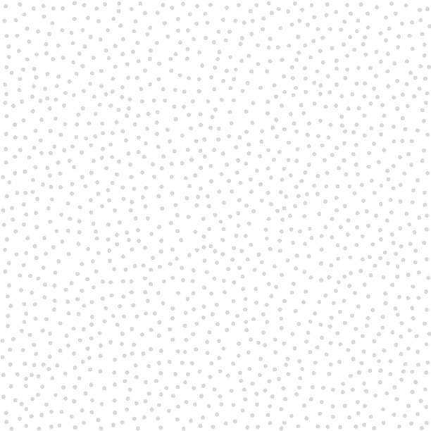 Stippled vector texture background - Gray dots on white Stippled vector texture background - Gray dots on white polka dot stock illustrations