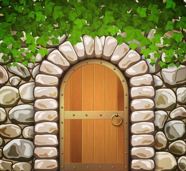 bildbanksillustrationer, clip art samt tecknat material och ikoner med stone wall with arched medieval wooden door and leaves - wood stone
