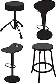 Vector silhouettes of four various stools.