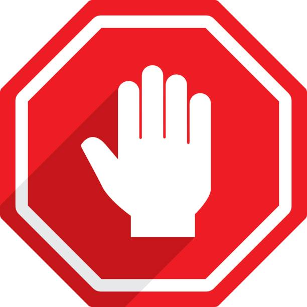 Stop Sign Hand Icon Vector illustration of a red stop sign hand icon in flat style. stop stock illustrations