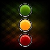 Green, orange and red buttons as stoplight symbol.
