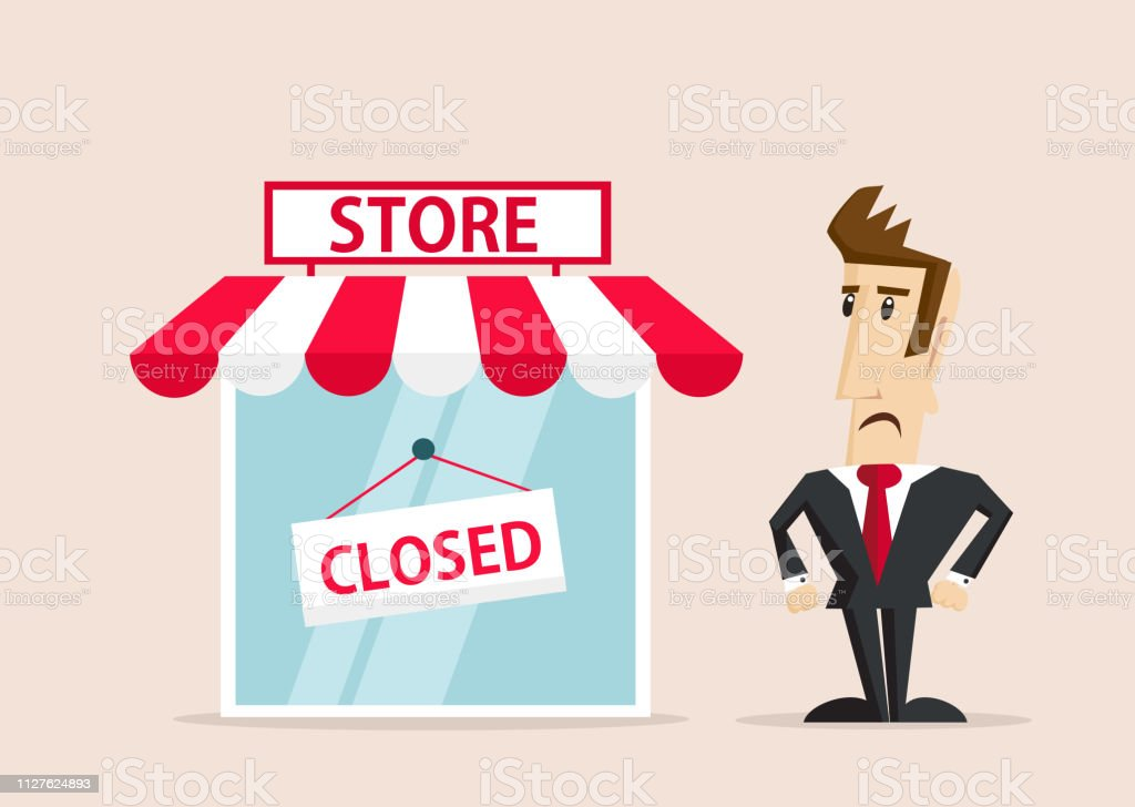 Unhappy businessman standing next to store with closed sign