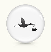 Stork Brings Baby Icon on simple white round button. This 100% royalty free vector button is circular in shape and the icon is the primary subject of the composition. There is a slight reflection visible at the bottom.