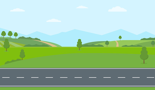 Straight empty road through the countryside. Green hills, blue sky, meadow and mountains.