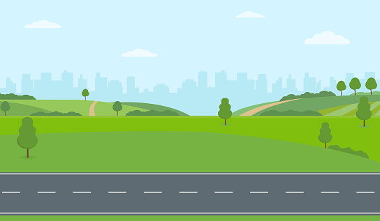 Straight empty road through the countryside on city background. Green hills, blue sky, meadow.