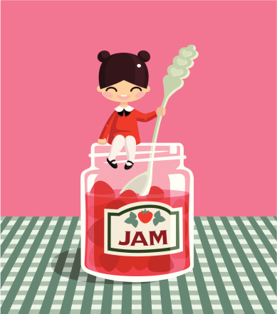 A small girl is sitting on a large jar of jam.