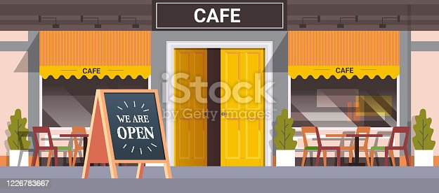istock street cafe facade with we are open board urban building house exterior coronavirus quarantine is over 1226783667